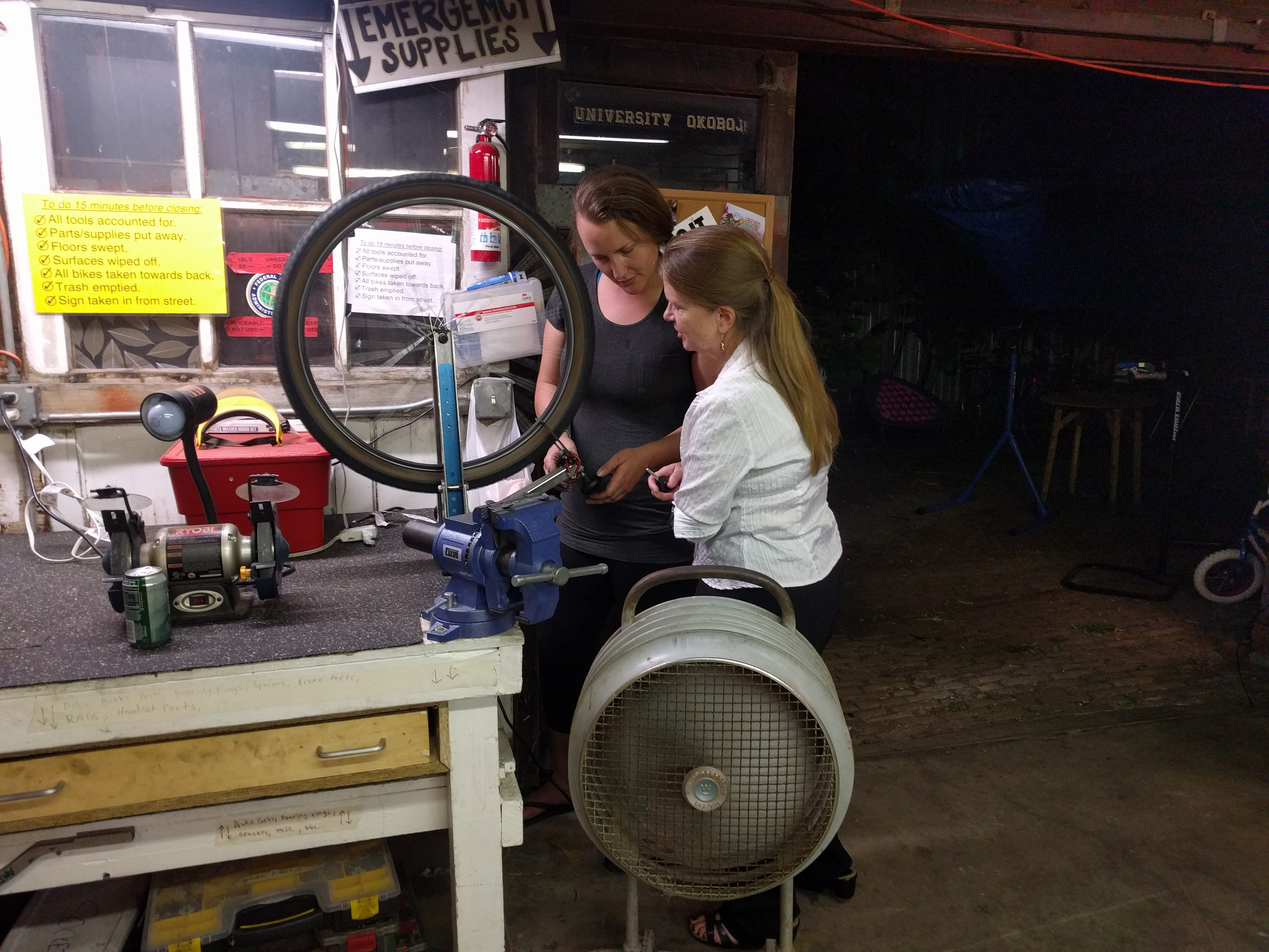 Desiree Kuhn, discussing truing wheels with Jane Halliday