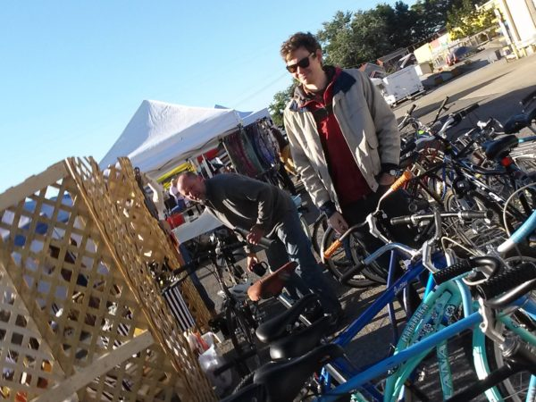 John and Seth setting up bikes at the flea off